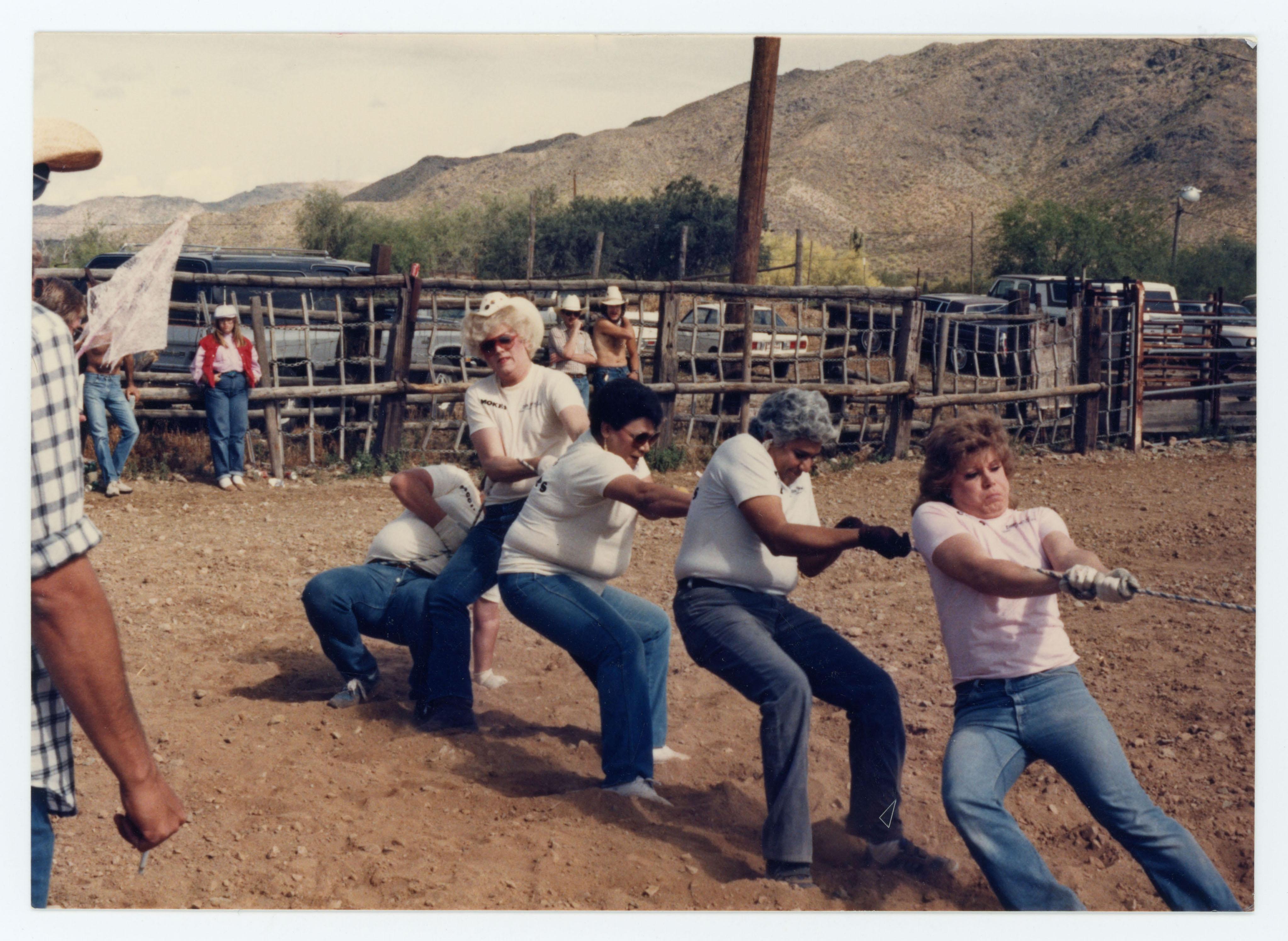 People playing tug o'war; Arizona Gay Rodeo Association; 1985