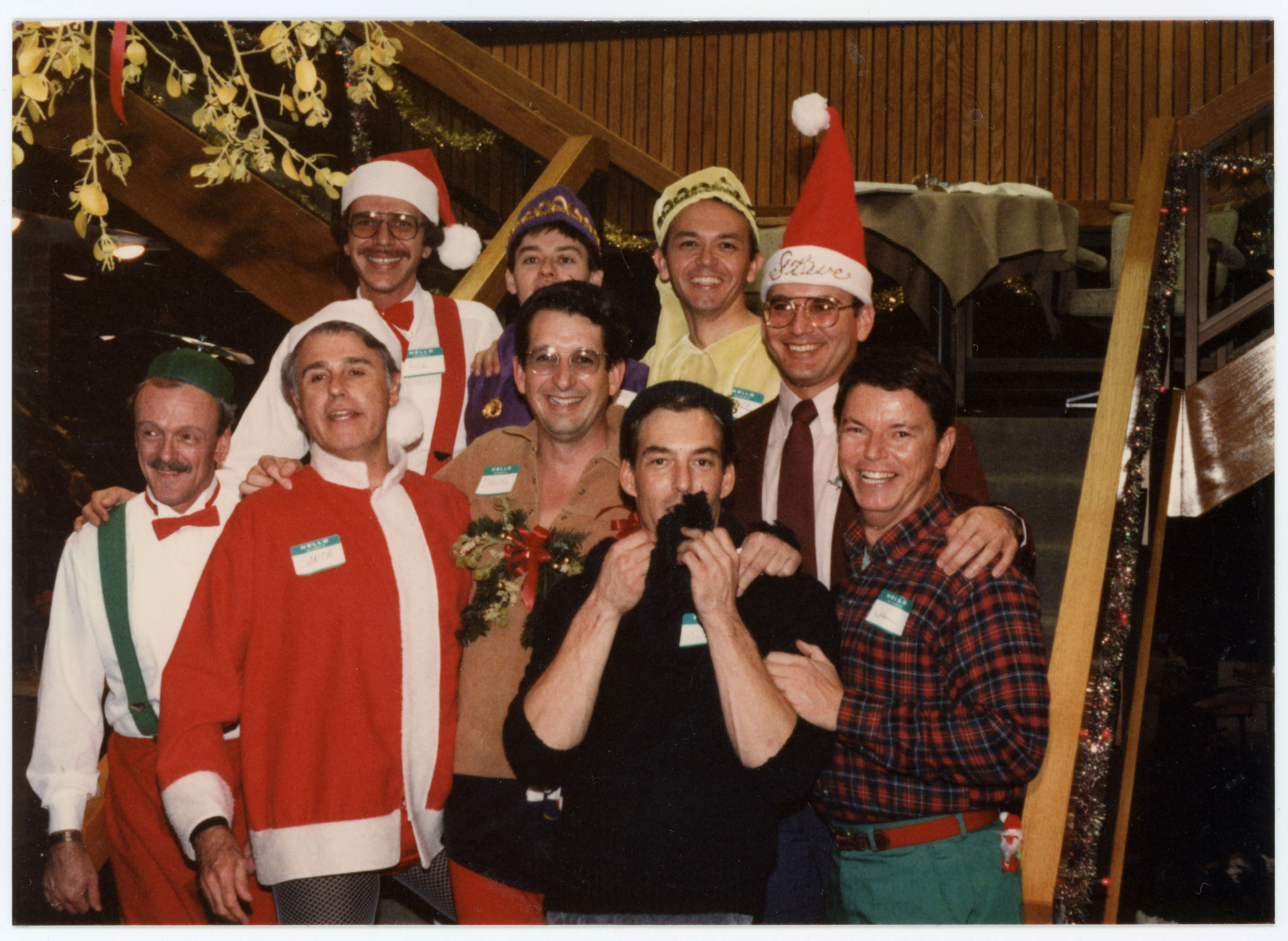 Group posing in Christmas outfits; 1985