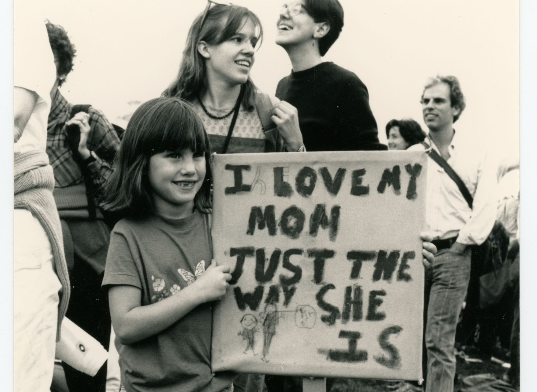 "Child with sign reading ""I love my mom just the way she is""; March on Washington for Lesbian and Gay Rights; 1987"