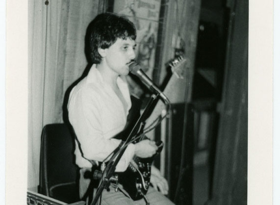 Person performing with electric guitar