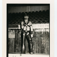 Man in leather on stage performing