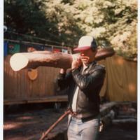 Man carrying log