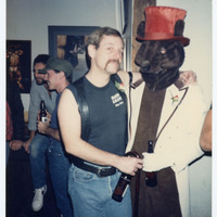 Man posing with person in bear costume