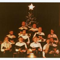 Men singing in choir performance