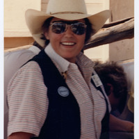 Woman posing with cowboy hat