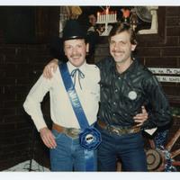 Two happy men posing for photo