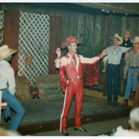 Man in red cowboy outfit