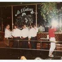 Group of men at bar