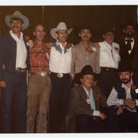 Group of men in cowboy hats posing